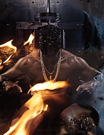Speaking of Almighty Yeezus, here's Kanye West in a photoshoot for Interview magazine. It was shot by Steven Klein who directed Lady Gaga and Britney Spears videos. Unsuprisingly, there is mind control in the photoshoot. Here, Kanye is sitting in what appears to be an electric chair with an uncomfortable mask on his head.