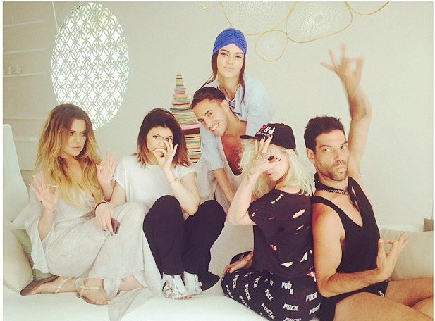 Here's Khloe Kardashian and some peeps doing the a-ok triple-6 handsign. One of them is hiding one eye. They're soooo cool and hip. I wish I was there with them posing for this pic like a moron.