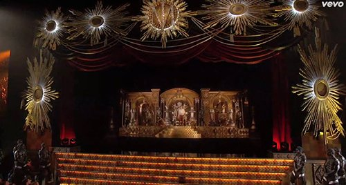"""In fact, the entire stage is one big Masonic lodge, complete with twin pillars (formed by chess pieces), an arch overarching them, a checkboard pattern surrounded by """"blazing stars"""" as found in lodges."""
