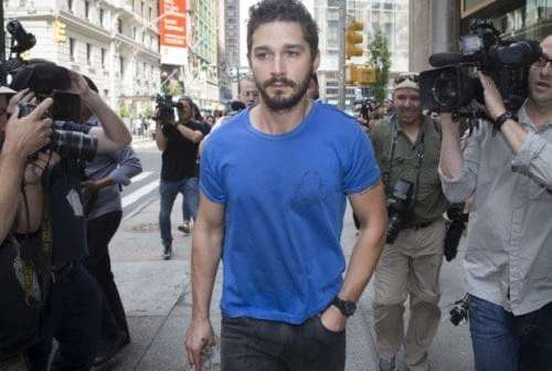 "Actor Shia LaBeouf walks through the media after leaving Midtown Community Court following his arrest the previous day for yelling obscenities at a Broadway performance of ""Cabaret"", Friday, June 27, 2014, in New York."