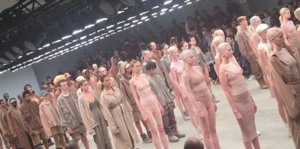 The models were ordered according to skin tone, while wearing clothes that matched their skin tone. Again, is this post NWO fashion?