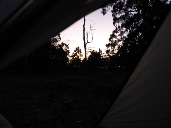 Waiting for the sunrise in the tent. Make it warmer!