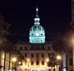 A picture of the Savannah City Hall at night.