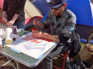 Steve Lambert Improving OccupyBoston Signs with Josh Luke photo