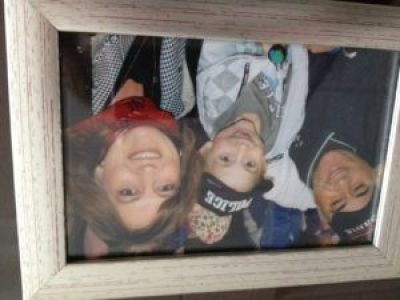 Kathi Cozzone (right), son Victor (now 10) and husband Victor in a recent family photo.