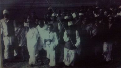 Gandhi on a peace march at Noakhali