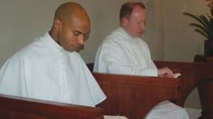 Fr. Claude (l) and a confrere at prayer
