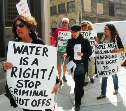 Marchers protest thousands of water shut-offs May 23 outside Water Board Building in downtown Detroit