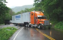 A tractor-trailer backs into the parking area at the top of Smugglers Notch on a Tuesday morning in June after the driver realized that, yes, the Notch Road is too narrow and winding for trucks like his. It managed to reverse course and head back to Jeffersonville. Photo by Glenn Callahan/Stowe Reporter