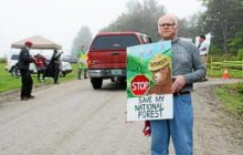 Protesters greet governor at wind project ceremony