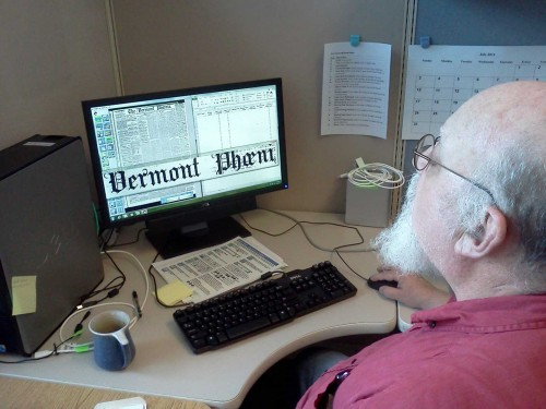 UVM Cataloging and Metadata Specialist Michael Breiner performing some frame by frame inspection of the Vermont Phoenix newspaper. Photo courtesy of Tom McMurdo.
