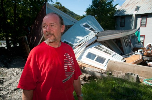 Jon Graham stands in front of what's left of his house after Tropical Storm Irene tore through Rochester. VTD/Josh Larkin