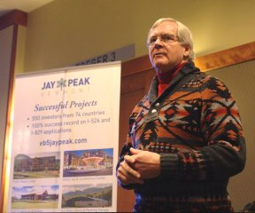 Bill Stenger, owner of Jay Peak and Burke Mountain resorts, shows lawmakers plans for development in the Northeast Kingdom on Feb. 5, 2013,at Jay Peak. Photo by Nat Rudarakanchana