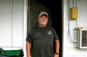 Dennis Kucera stands outside the door to his room at the Shady Lawn Motel in White River Junction in Sept. 2010. Valley News photo by  Jennifer Hauck