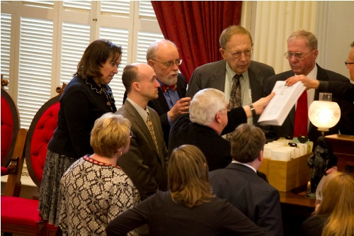 A bunch of lawmakers surround Majority Leader Willem Jewett, as opponents of a gas tax try to enter a petition into the record on Wednesday, March 20,2013. Photo by Nat Rudarakanchana