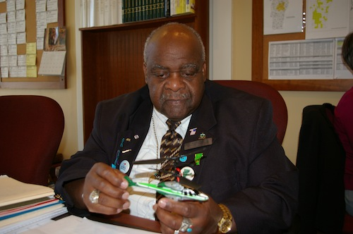 Rep. Kevin Christie, D-Hartford, holds a remote controlled helicopter, similar to smaller unmanned drones that law enforcement agencies across the country are seeking to acquire. Photo by Andrew Stein.