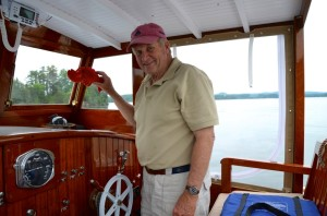 "Jan Rozendaal holds up ""Larry the Lobster,"" his mascot for the Maddy Sue, an iconic 1932 Maine lobster boat he had restored that now cruises on Lake Champlain - not known for its saltwater crustaceans. Photo by Andrew Nemethy"
