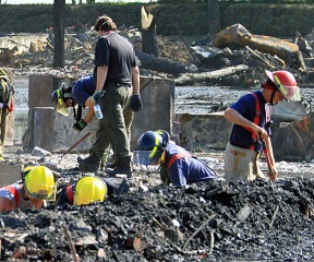 Recovery crews comb through the rubble of an explosion in Lac Megantic, Quebec. The July 6 crash involving runaway train cars loaded with crude oil killed at least 50 people, officials say. Photo courtesy cbc.ca