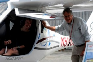 Alexandra MacLean of Jay Peak gets a tour of the CTLS cockpit from the plane's owner, Gary Forrester, of Newport, N.H. Photo by Hilary Niles/VTDigger