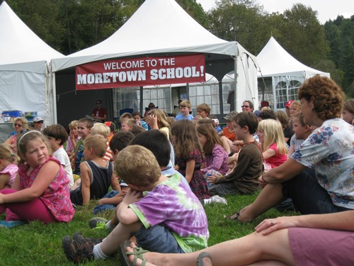 Students gathered in the backyard of the Moretown Elementary School under tents after Tropical Storm Irene flooded the school in 2011. Photo courtesy Moretown Elementary School.