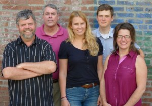 New VTDigger staff: From left to right, Rick Woods, co-publisher, Tom Brown, assignment editor, Viola Gad, intern, John Herrick, intern, and Hilary Niles, business and data reporter. Photo by Anne Galloway