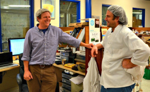 Mateo Kehler, right, talks with his brother and partner Andy in the office at Jasper Hill Farm, where the two produce and age six cheeses and also age eight others for other Vermont cheesemakers. Photo by Andrew Nemethy