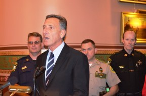 Gov. Peter Shumlin, flanked by law enforcement, lawmakers and advocates, announces his proposal in the Cedar Creek Room at the Statehouse. At left his Washington County Sheriff W. Samuel Hill. Photo by Alicia Freese/VTDigger