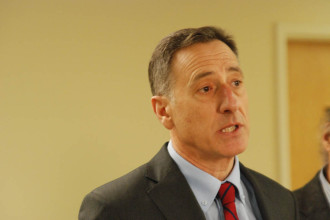 Gov. Peter Shumlin speaks with reporters at a bill-signing ceremony in South Burlington. Photo by John Herrick/VTDigger