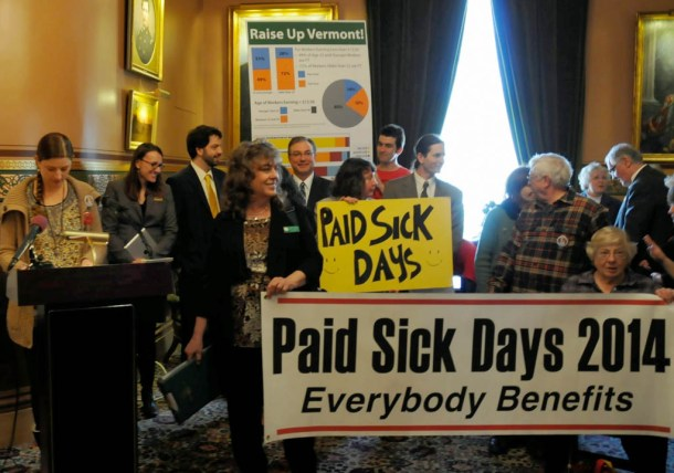 Activists gather at the Statehouse for a news conference sponsored by Ben & Jerry's to push for paid sick leave laws and a minimum wage raise. Photo by Hilary Niles/VTDigger