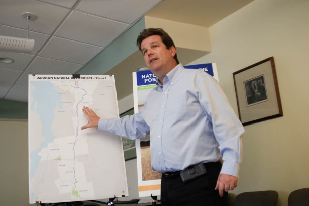 Vermont Gas spokesman Steve Wark points to a map of the company's pipeline extension proposal at a media roundtable in South Burlington on Tuesday. Photo by John Herrick/VTDigger