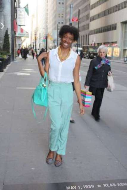 The classically pressed, loose-fitting trouser of this woman's ensemble wouldn't be the same without its breezy turquoise color. Offset by a slouching blouse, chunky 80s neck garb and a perfectly beaming smile, this outfit-personality combination establishes the type of timeless class stylists of all generations strive to achieve. Casual, comfortable & totally pro-pastel, we're certainly fans of this outfit!