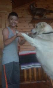 Sean having fun with the family dog.