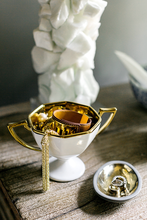 Gold trinket dishes as nightstand essentials