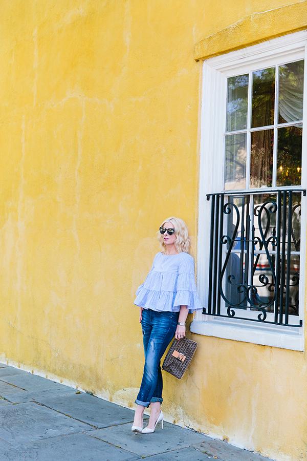 Blue ruffle top and Karen Walker sunglasses