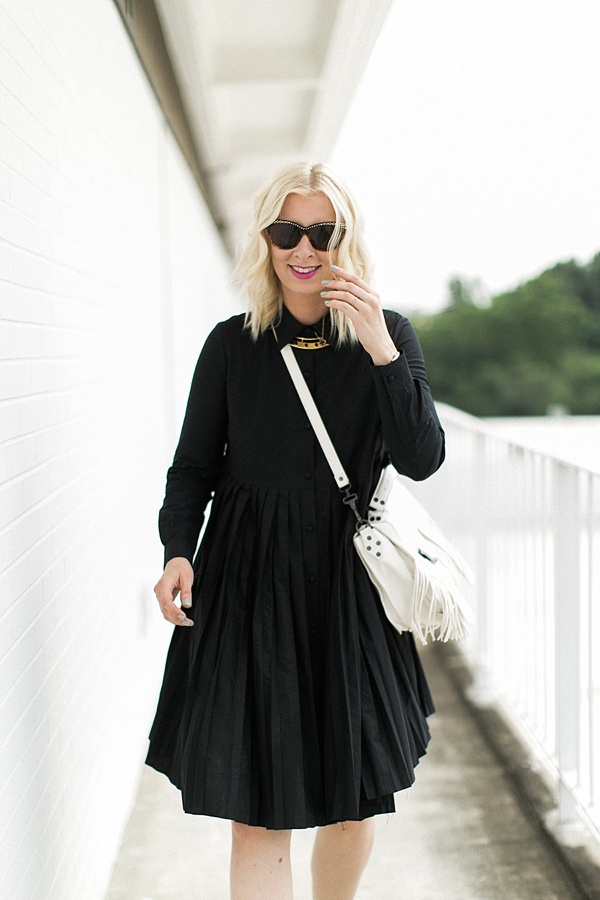 Black dress and white crossbody bag, Waiting on Martha