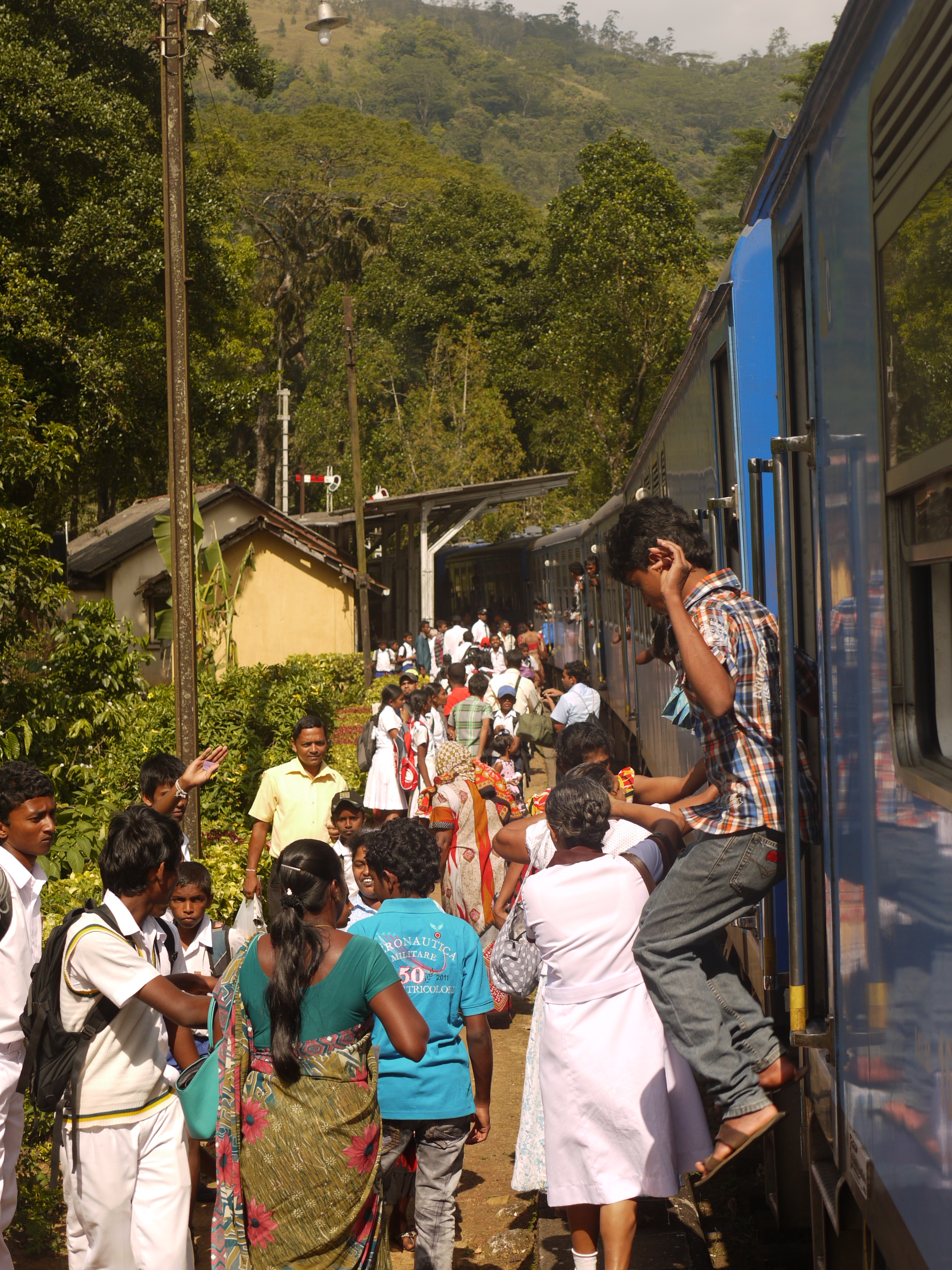 Jumping down from the train at a busy station during 'Sri Lanka's most beautiful train journey'