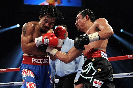 Marquez shows Pacquiao how to throw an uppercut
