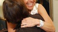 Katie Couric hugs Margaret Suzor