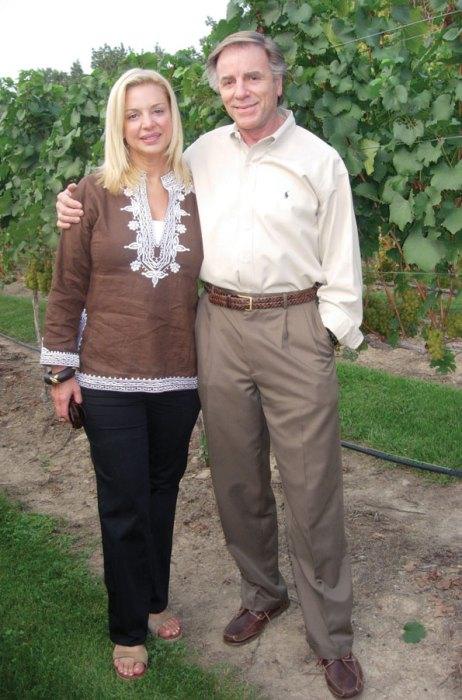 Holli and Moses Thompson among the vines at their Maizemoor Vineyards.