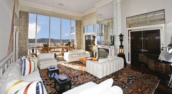 The late Melvin and Estelle Gelmans' 2-story-high living room looks out on upon an expansive penthouse terrace on 4201 Cathedral Avenue, NW.