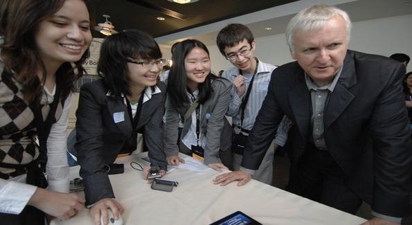 Christina Fries, Tianlu Zhang, Christina Chang and Cameron Solomon of Team Fortran C from UCLA show their game to James Cameron