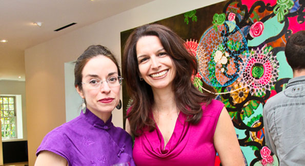 Guests Andrea Pollan and Nadine Gabai-Botero take in the Podesta's collection. Photo by Tony Powell.
