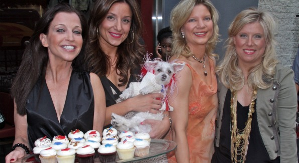 Guests enjoy Georgetown Cupcakes at White House Pet's Correspondence Benefit. Image courtesy of Animal Fair.