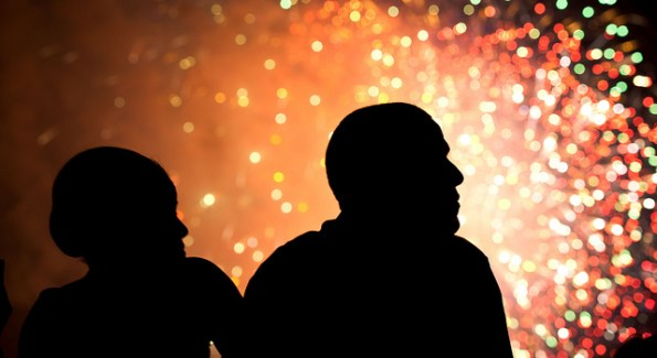 President Barack Obama and First Lady Michelle Obama watch fireworks from the roof of the White House, July 4, 2011. Official White House Photo By Pete Souza.