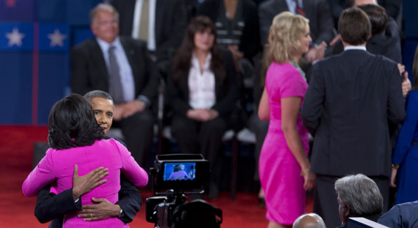 Michelle Obama and Ann Romney made their own debate news with their matching hot pink dresses, reportedly for breast cancer awareness. (AP Photo/Carolyn XXXXXX)
