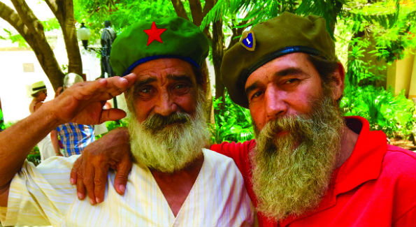 Cuba men saluting