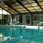 Indoor Pool enclosed in a glass room Heated at Colonial House Motel in Pigeon Forge