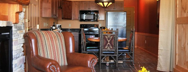 Deluxe Family Suite at the River Loge Wilderness At the Smokies view of the living room and kitchen wide