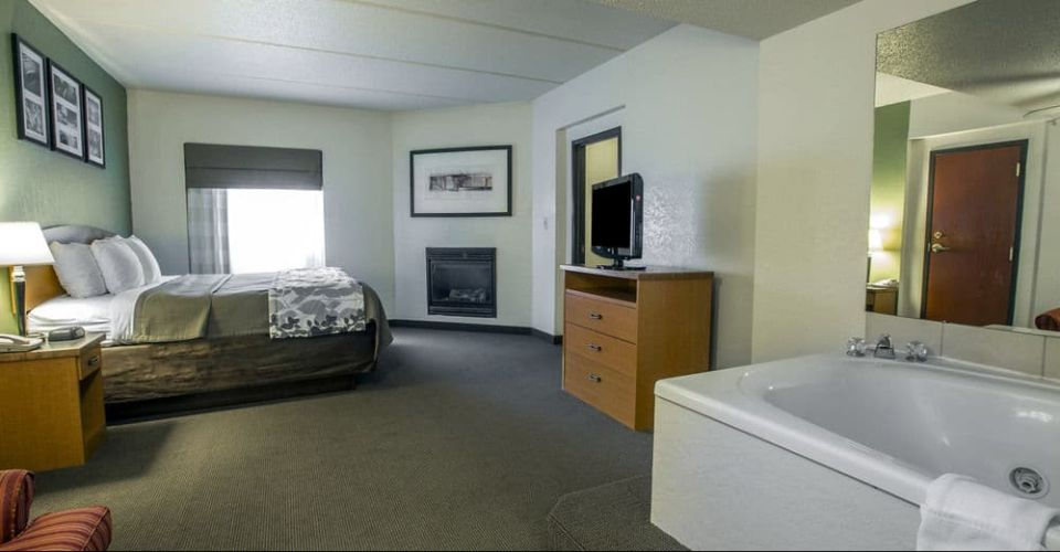 View of the 1 bedroom king suite with 2 person Jacuzzi and fireplace Sleep Inn Suites Gatlinburg 960