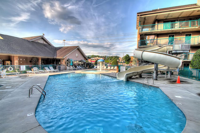 View of the Outdoor Pool and Cruvy Water Slide at the Willow Brook Lodge in Pigeon Forge Tn
